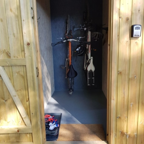Each cabin has an integrated bike and equipment storage area