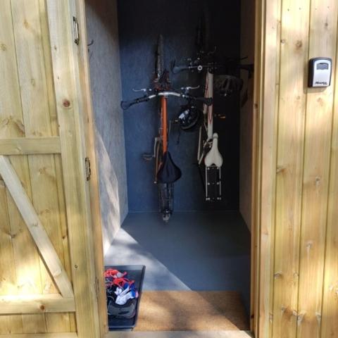 In-cabin bike and equipment storage area