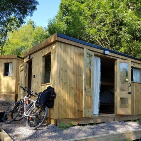 Cabins surrounded by trees and with plenty of natural light and blackout curtains