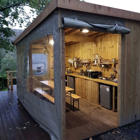 A kitchen with walls rolled up
