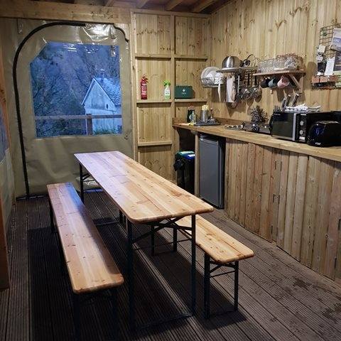 The kitchen has plenty of seating and facilities with walls that roll up or down according to the weather