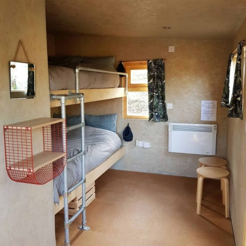 Big 4ft bunks with cosy bedding and heater