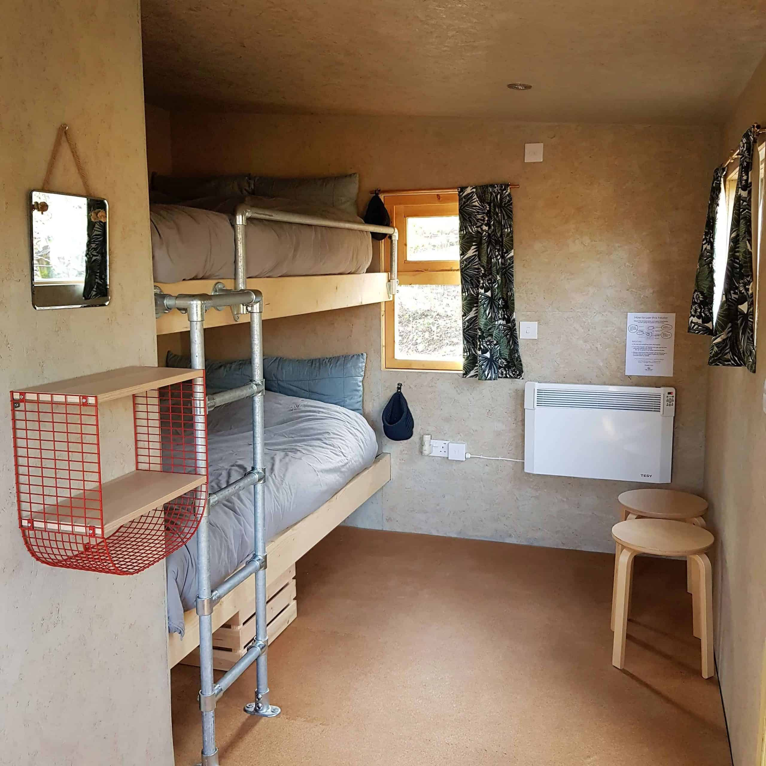 Big 4ft bunk beds with cosy bedding and heater