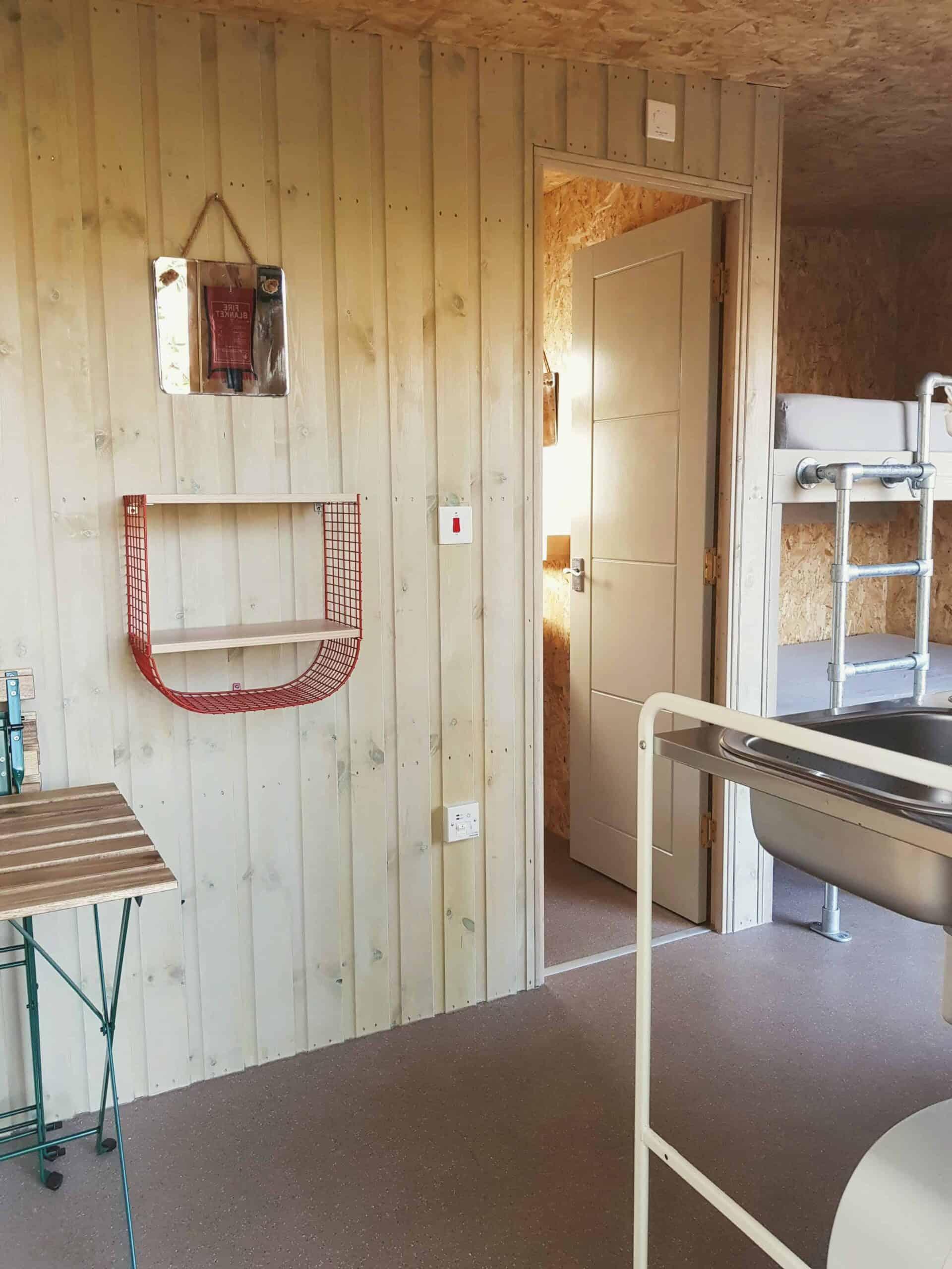 cabin fittings mirrow shelf table beds door to ensuite
