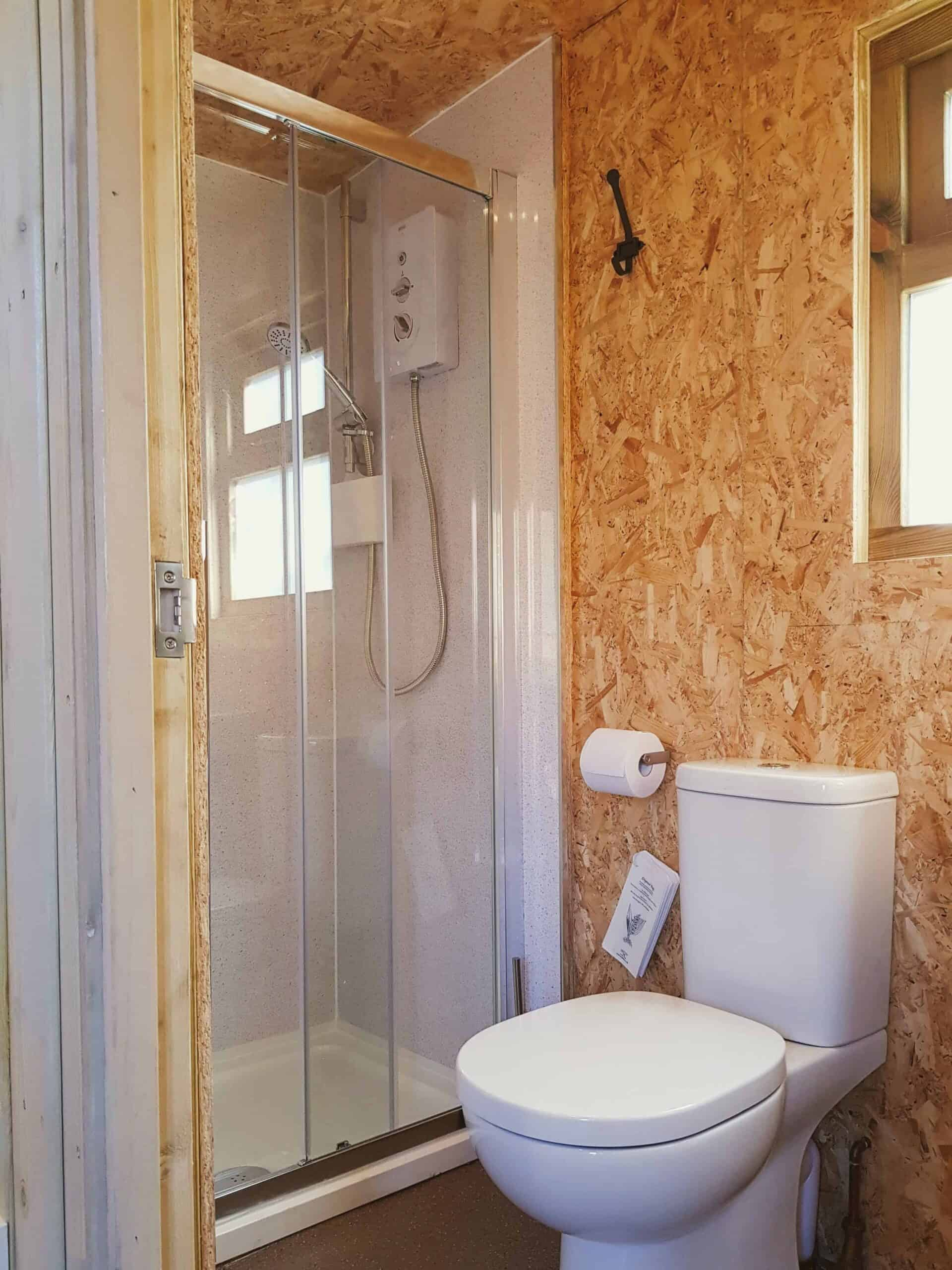 Cabin ensuite with electric shower and toilet