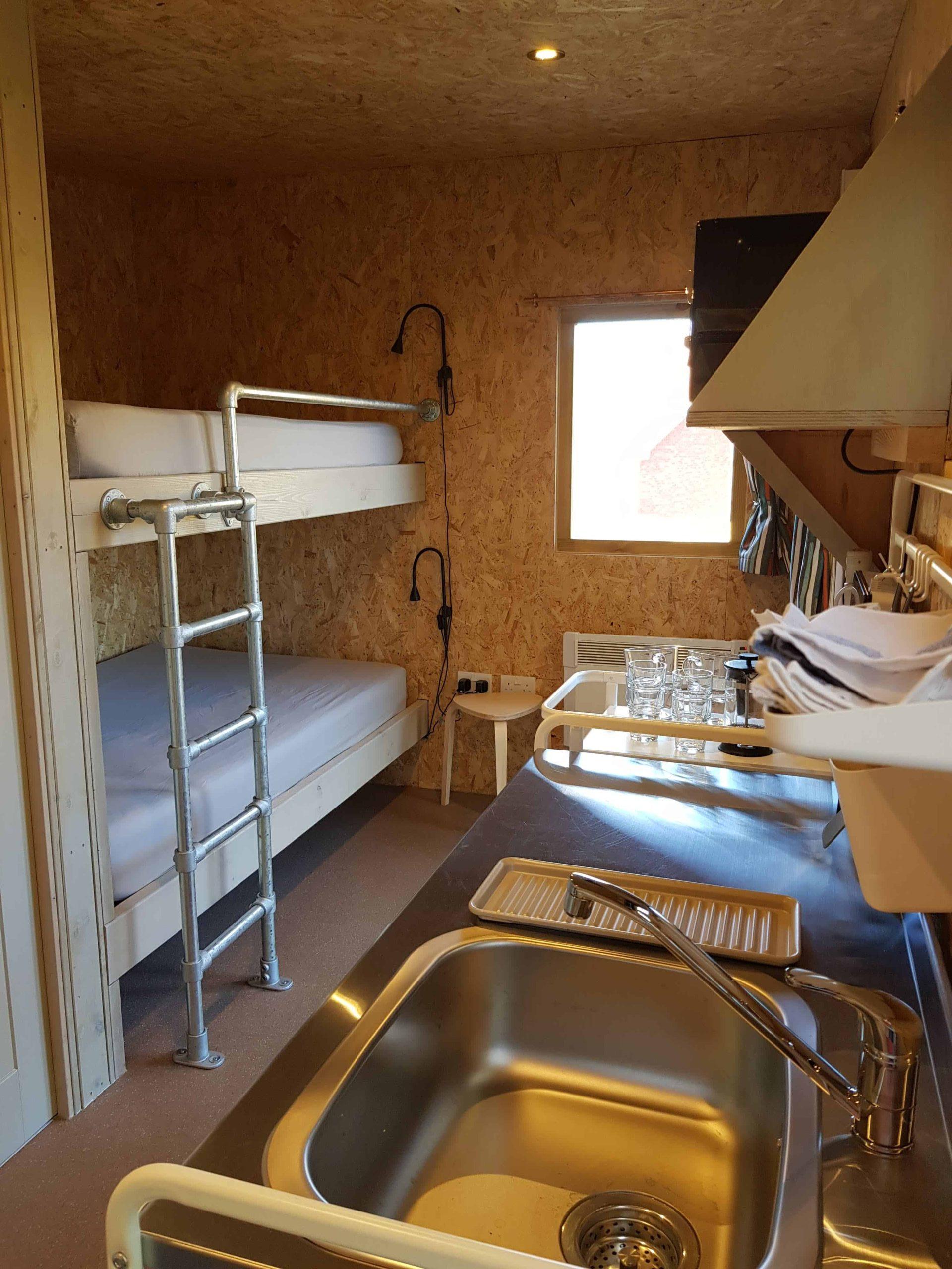 Cabin bunk bed, ladder, kitchenette, window