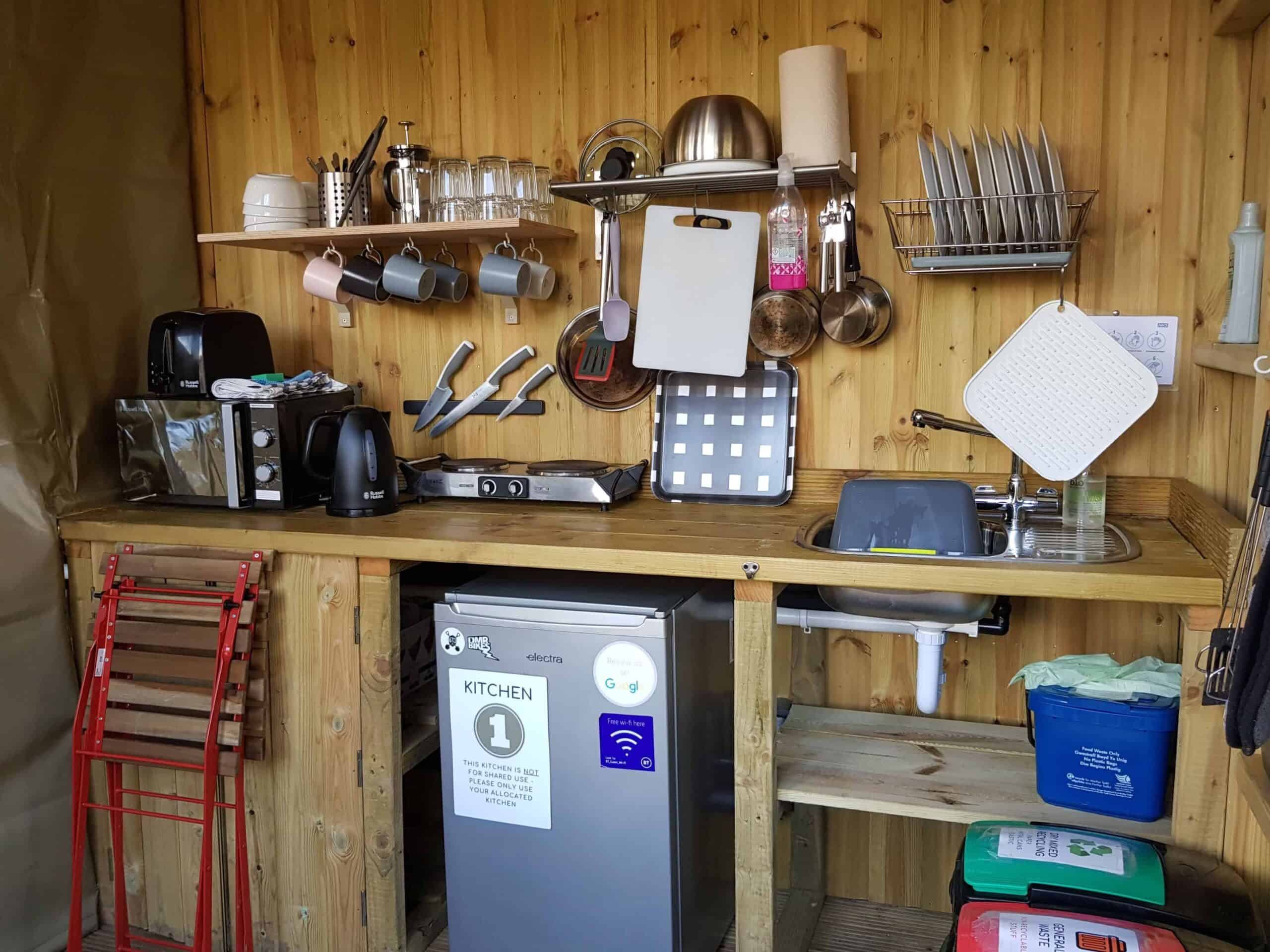 A well kitted out kitchen with sing, two ring hob, fridge, a microwave, kettle, toaster, pots, pans, utensils, crockery, cutlery, tea towels, washing up liquid, hand wash...