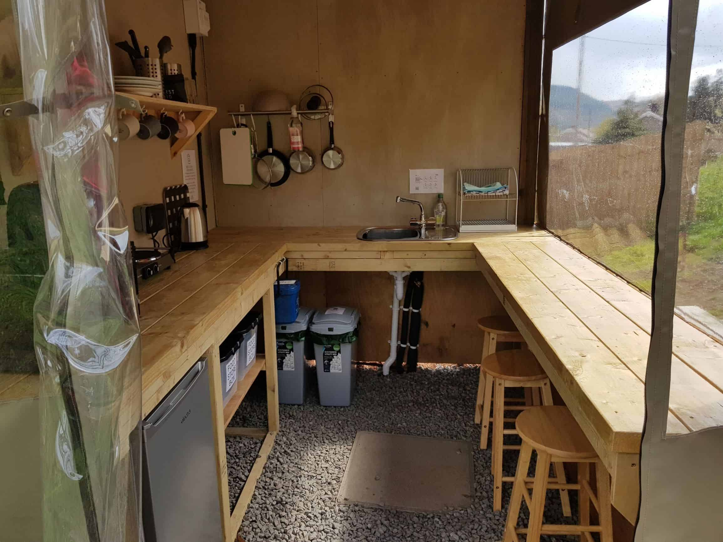 Camping kitchen with sink hob fridge microwave seating
